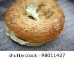 Bagel with cream cheese for breakfast. - stock photo
