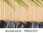 The spa a stone on bamboo background - stock photo