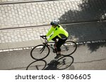 an unidentifiable person on a bicycle rides to their destination - stock photo