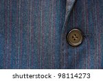 Button on a business suite - stock photo