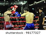 BANGKOK, THAILAND- MARCH 21 : Unidentified athletes compete in World Amateur Muaythai Champioships 2012. on March 21, 2012 at National Stadium, Bangkok, Thailand - stock photo