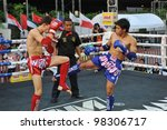 BANGKOK, THAILAND- MARCH 22 : Unidentified athletes compete in World Amateur Muaythai Champioships 2012. on March 22, 2012 at National Stadium, Bangkok, Thailand - stock photo