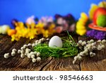 Easter egg on old rustic wooden table - stock photo