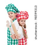 Happy chef kids holding wooden cooking utensils and smiling - isolated - stock photo