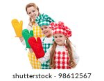 Happy chefs family standing in row waving with oven gloves - isolated - stock photo