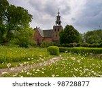 Church at a european village under a  dramatic sky - stock photo