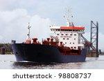 Tanker passing the entry of the docks in Antwerp harbor - stock photo