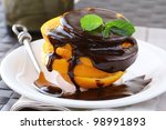 fresh orange in chocolate sauce - a great dessert - stock photo