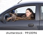 beauty woman sitting in the car - stock photo