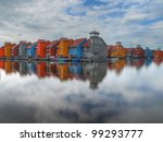 Colorful houses on the waterfront in a newly built suburb in the Netherlands - stock photo