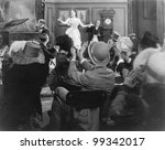 Young woman performing for a group of spectators - stock photo