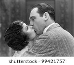 Closeup of couple kissing - stock photo