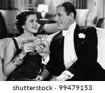 Portrait of couple having drinks - stock photo