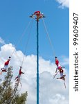 """TULUM, MEXICO - JULY 15: Unkown Voladores men at """"Flying Men Dance"""" ceremony. The ritual pleased the rain god Xipe Totec and was started in 5th Century. July 15, 2011 in Tulum, Quintana Roo, Mexico - stock photo"""