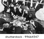 High angle of a group of people playing roulette - stock photo