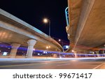 Highway and roads with light trails at night - stock photo