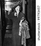 Elegant woman waving - stock photo