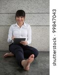 Asian Business woman using a touch pad - stock photo
