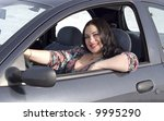 happy woman in the car - stock photo