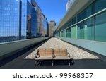 bench among buildings in boston, massachusetts. - stock photo