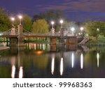 Lagoon Bridge and skyline of Boston, Massachusetts fromthe Boston Public Gardens. - stock photo
