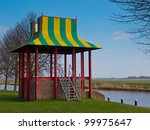 Colorful modern music chapel on the river bank - stock photo