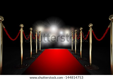 stock-photo-red-carpet-between-two-rope-barriers-and-flash-light