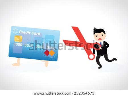 businessman cutting up credit