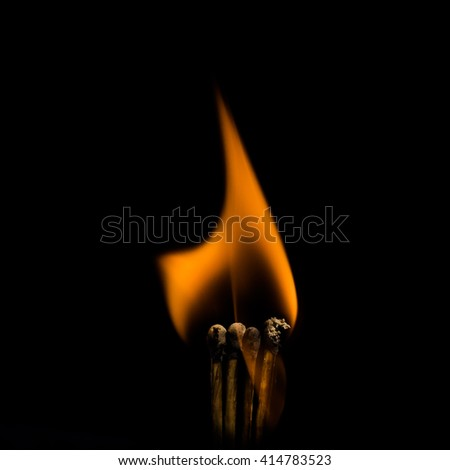 A beauty of burning match, isolated in black background. Fire styling. - stock photo