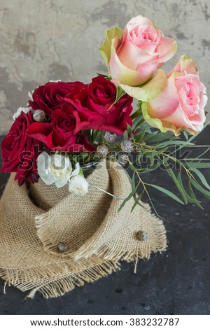 A bouquet of flowers of roses, carnations and other flowers  - stock photo