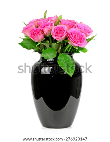 a bouquet of roses in a black vase - stock photo
