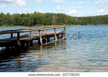 a bridge over the lake - stock photo