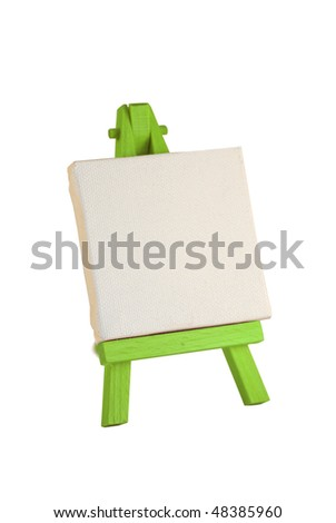 a customizable blank canvas on a wooden tripod - stock photo