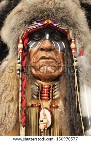A face of an old Native American Indian in full headdress - stock photo