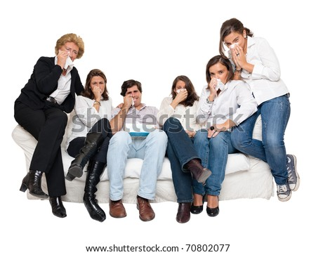 A group of family members sitting at home crying watching tv - stock photo