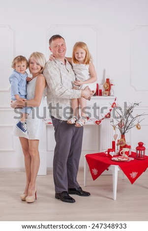 A happy family with kids at home - stock photo