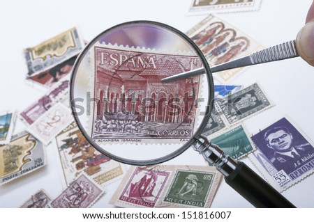 a magnifying glass Have postage stamps - stock photo