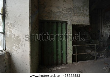 A photo of an old lift door - stock photo