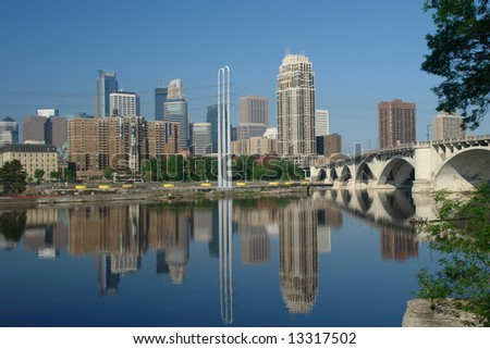 A picture of downtown Minneapolis with reflections in river - stock photo