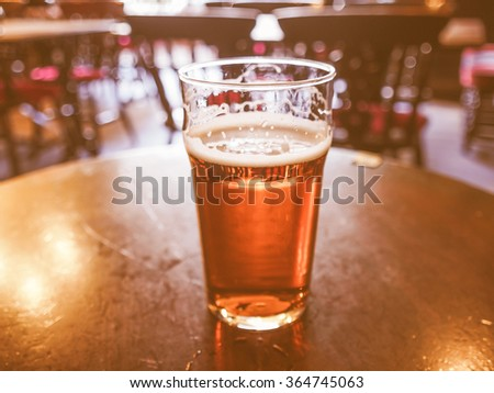 A pint of English ale beer in a pub vintage - stock photo