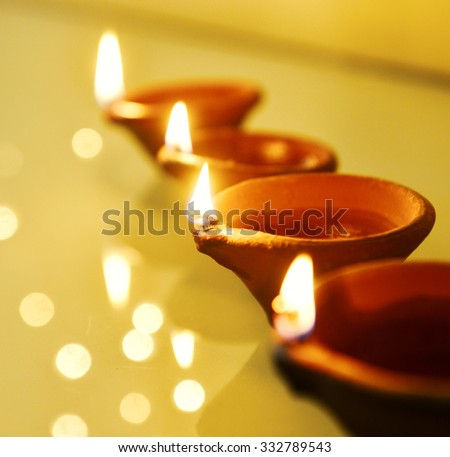 A row of traditional indian oil-lamps. - stock photo