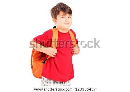 A school child with a backpack posing isolated on white background - stock photo