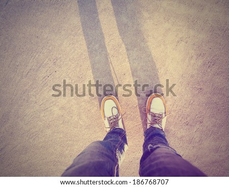 a shot of yellow and white boat or deck shoes done with a retro vintage instagram filter  - stock photo