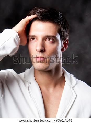 A trendy European man dressed in contemporary cloth. - stock photo