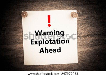 a warning of Exploitation aheadconcept on note paper - stock photo