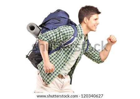 A young hiker with backpack running isolated on white background - stock photo
