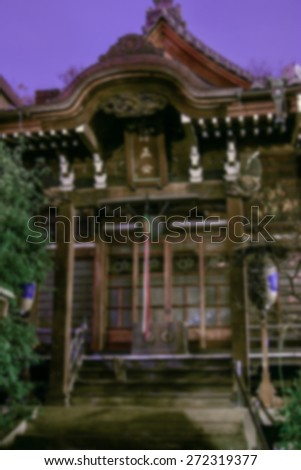 """""""Abstract Background Blurred Image"""" Traditional Japanese shrine structure at night.  (Blur style image) - stock photo"""