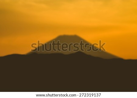 """""""Abstract Background Blurred Image"""" View of the historic Mt Fuji at sunset as seen from Tokyo, Japan. (Blur style image) - stock photo"""