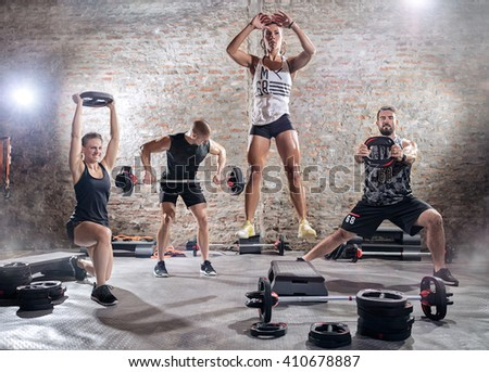 Active sporty people workout weights, lifting training - stock photo