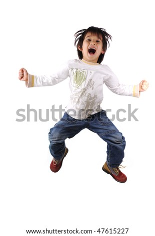 Adorable child jumping a over white background - stock photo